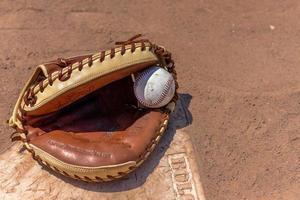 catchers guante y beisbol foto