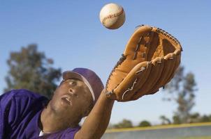 Baseball Outfielder Catching Fly Ball photo