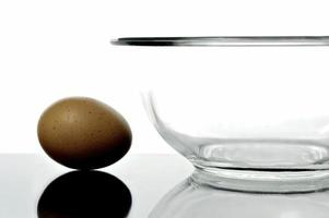 Egg and a glass bowl isolated and backlit photo