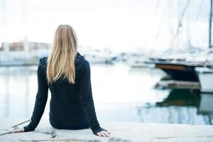 young girl sitting in the port
