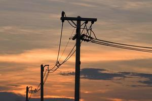 Silhouettes of the power lines and wires photo
