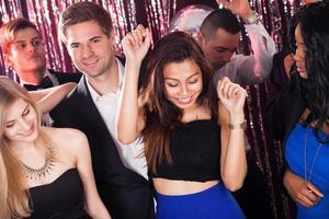 Cheerful Friends Dancing In Nightclub photo