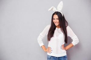 Cheerful woman in bunny ears