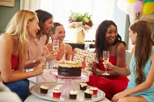 Group Of Female Friends Celebrating Birthday At Home photo