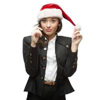 young cheerful businesswoman in santa hat on white photo