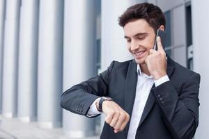 Cheerful young man is talking on the telephone