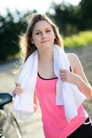 fitness sport healthy cheerful young woman running outdoor countryside photo