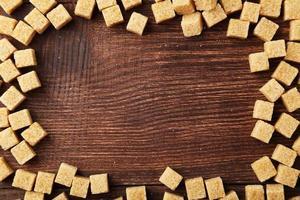 Brown sugar on brown wooden background