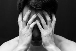 hombre guapo asiático en retrato de emoción en blanco y negro photo