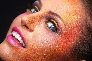 Pretty Girl With Extreme Spattered Make Up on the Face photo