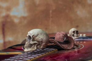 Skull and hat on a classical guitar. photo