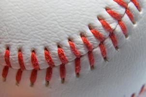 Close in view of a baseball and red stitches