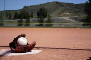 game field, glove and home plate photo