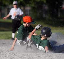 Baseball player sliding into base photo