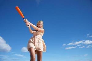 Teenage girl playing baseball photo