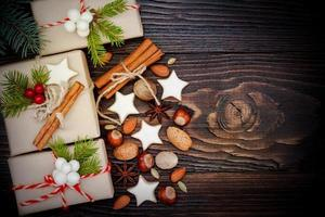 Christmas presents in boxes on a wooden background, copy space