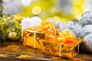 Festive Golden Gifts on Table with Decorations