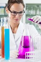 Woman doing experiment in laboratory