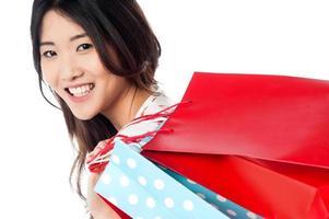Cheerful young shopaholic girl photo