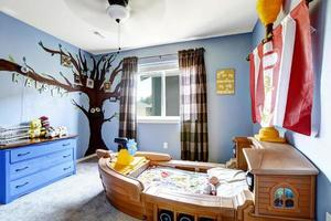 Cheerful kids room with boat bed