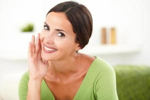 Confident cheerful woman looking at camera photo