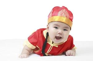 cheerful babies wearing Chinese New Year suit