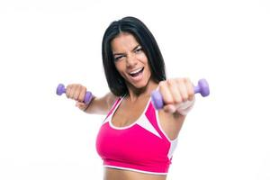 Cheerful fitness woman workout with dumbbells