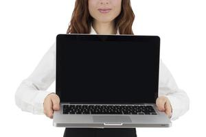 Business woman presenting laptop with copy space
