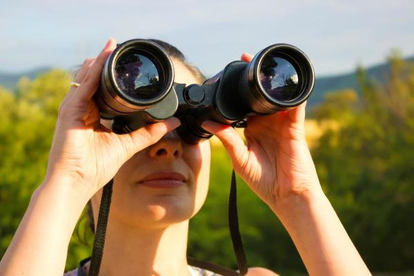Woman with binoculars 946684 Stock Photo at Vecteezy