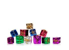 Miniature Christmas presents on white with copy space photo