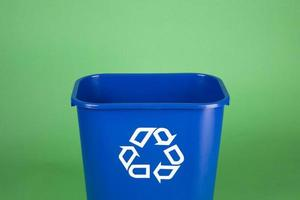 Recycling bin on green background with copy space photo