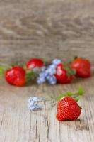 Strawberry on a rustic wood background, copy space
