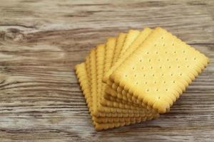 Classic crunchy biscuits on wooden surface with copy space