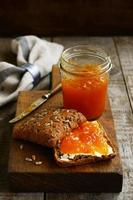 Apricot jam sandwich with copy space on dark background