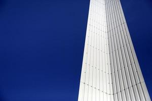 Modern geometry of metal with blue sky copy space