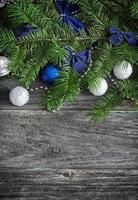 Christmas garland on rustic wooden table with copy space