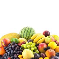 Border of mixed fruits isolated on white with copy space