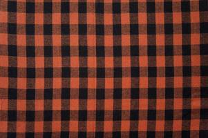 Red anb Black checkered tablecloth texture, background with copy space