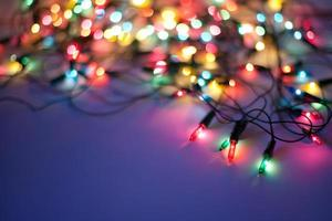 Christmas lights on dark blue background with copy space. Decora photo