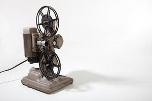 Vintage movie projector on a white background with copy space