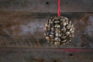 Ball Shape Pine Cone Christmas Decoration on Old Rustic Backgrou