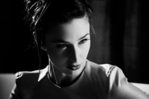 Portrait of fashion model closeup black and white photo