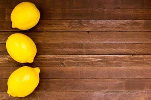 Lemons on wooden background, copy space