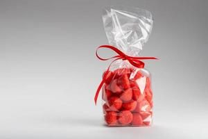Elegant gift of candy strawberries with copy space photo