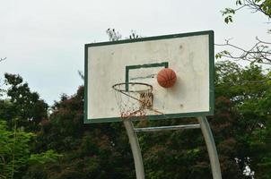 Old crack basketball board with hoop