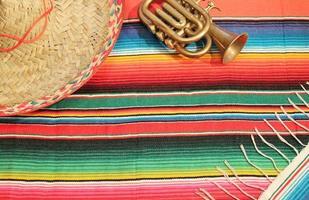 Mexican fiesta poncho rug sombrero trumpet copy space