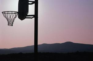 Basketball basket in midnight photo