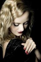 Pretty blond hair woman posing in studio photo