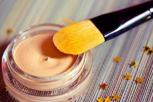 beauty and make-up: foundation product with brush