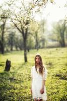 beautiful brunette woman walking outdoors photo